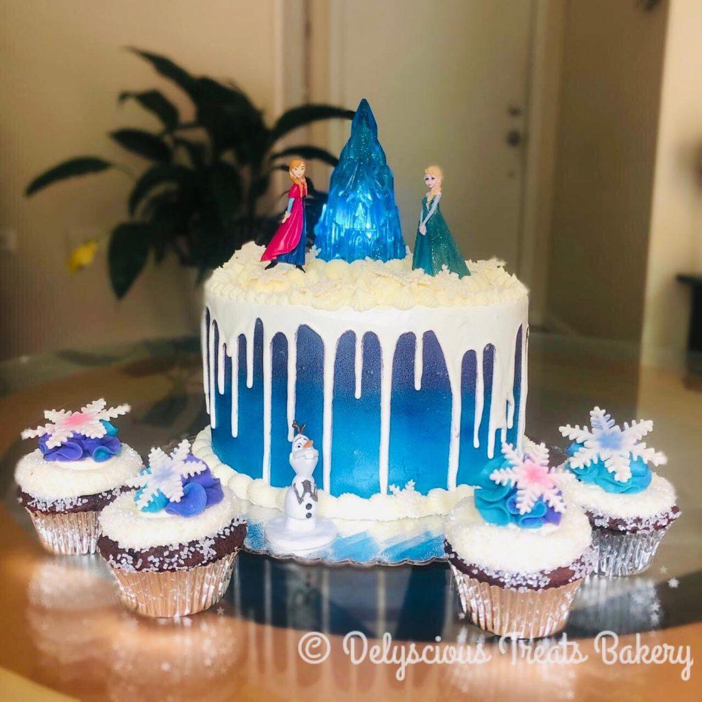 girl's birthday cake frozen themed anna elsa olaf cake buttercream white chocolate drip cake and buttercream cupcakes